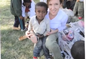 Diane Studer giving a Pair of Shoes in Ethiopia
