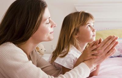 Teacher and Child Praying