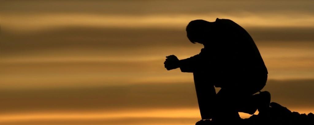 praying-and-kneeling-man